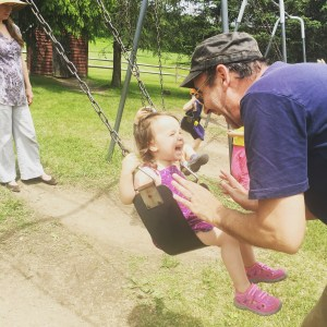 Baby Girl Laughing as Dad Pushes her on Swing at the park, Why Dads Matter, MomCaveTV.com
