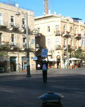 Israeli with a sign