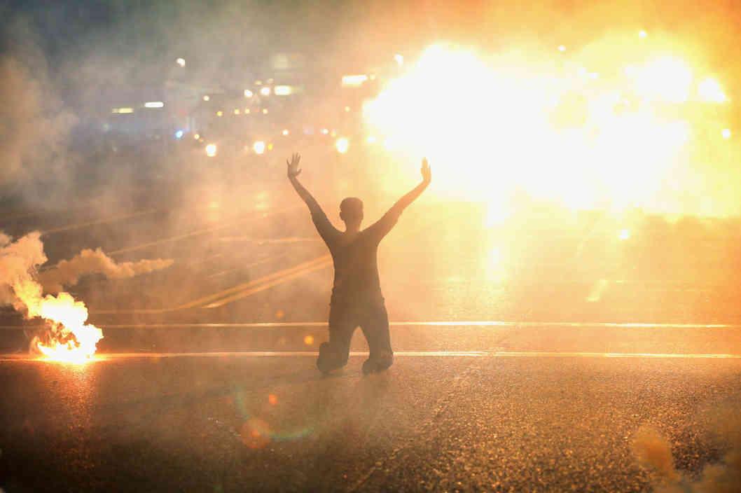 Ferguson Protestor Amid Flares