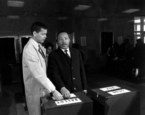 Julian Bond with Martin Luther King, Junior casting their ballots for Bond in the election for the Georgia House of Representatives, 1966.