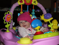 Victoria using her Exersaucer for the 1st time!!