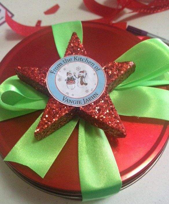 With a little ribbon, and an inexpensive ornament you can turn a simple tin of cookies into a fabulous gift! Photo Credit: Vangie Jaehn