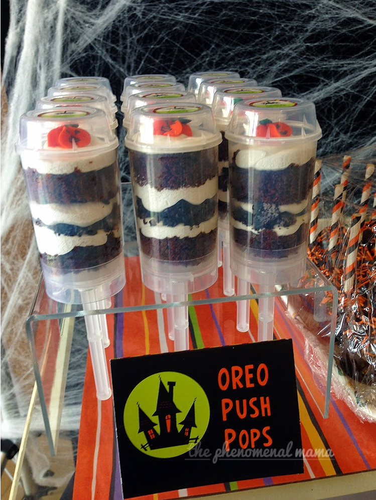 Oreo Push Pops were made with Devil's Food Cake, 7 Minute Icing, and Crushed Oreos. I was able to pick up the little candy pumpkins at our local bake supply shop.