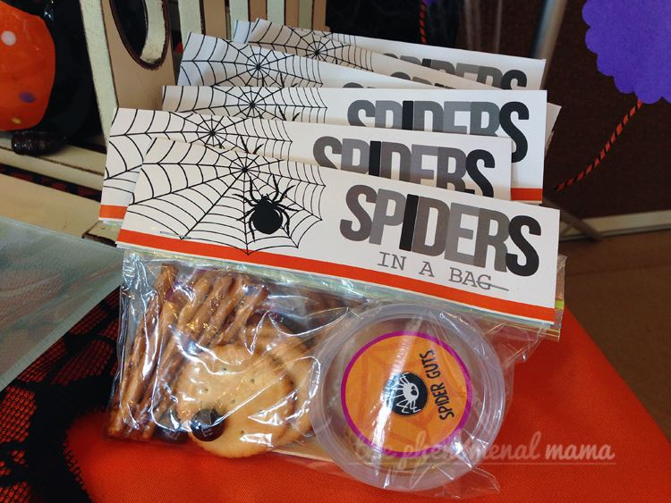 Not everyone wants sweets. This little Spider Kit gives someone the opportunity to put together a protein rich snack with crackers and peanut butter.  Instructions were carefully placed on the back of this cello bag topper by Tina.