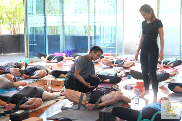 Day 1 - Pio with Donna assisting in strapping participants for baddha konasana
