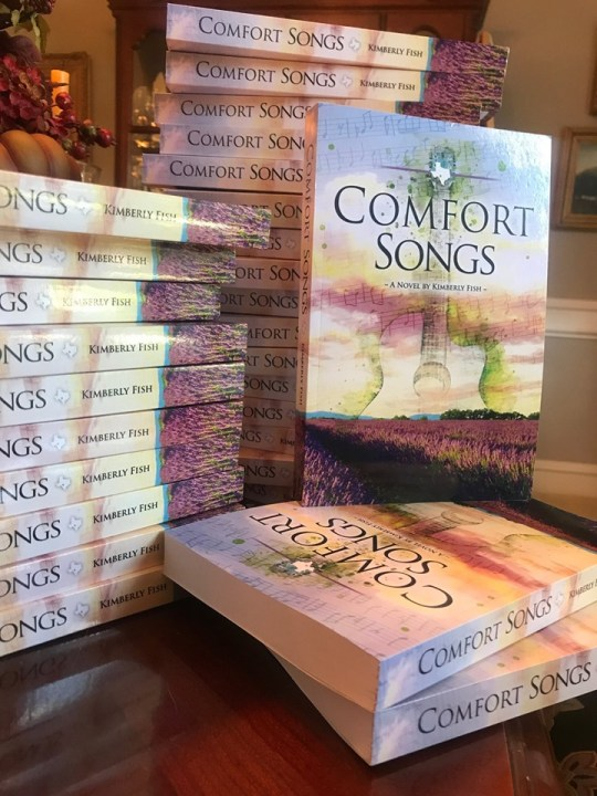 Image of stack of Comfort Songs paperbacks