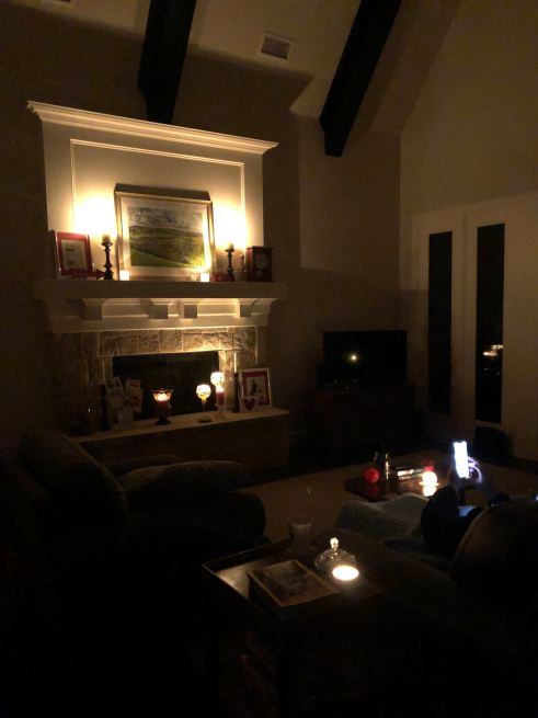 Thawed post image of a fireplace lit with every Partylite candle I own.