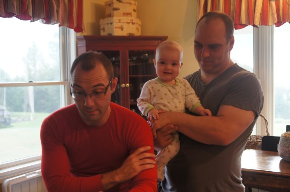 A dad, an uncle, and the cutest spriteling in the house.