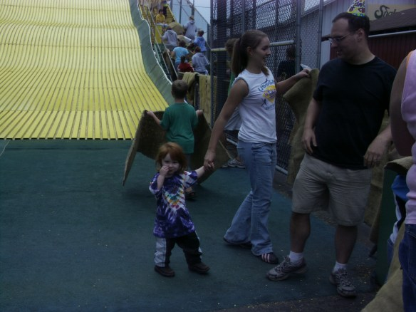 Best babysitter Jessica going down the slide with Monkey.