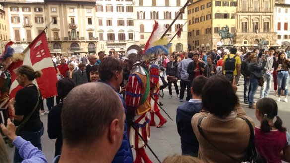 The ceremony taking place by the statue area near the Uffizi.