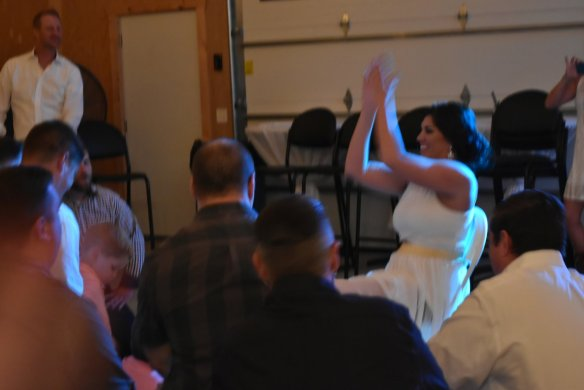 Singing a romantic song to the bride. Even Buddie's back looks uncomfortable.