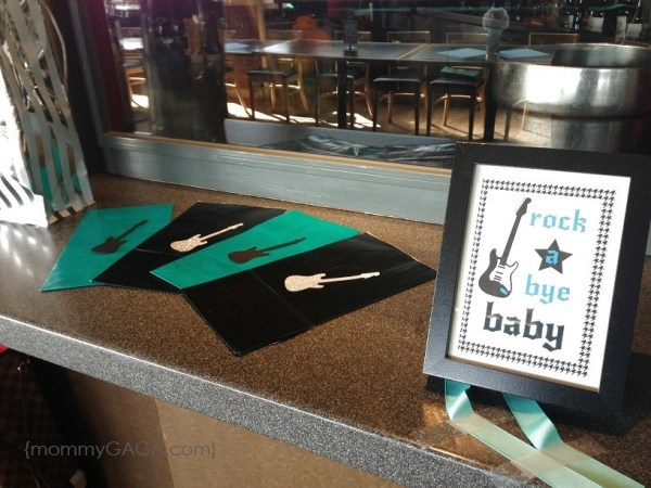 Rock-a-bye baby shower sign and prize bags