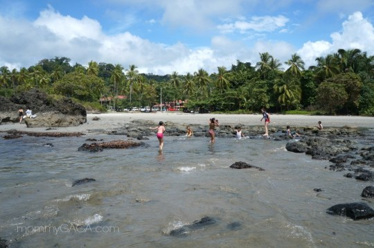 Kids playing at Manuel Antonio beach, Costa Rica