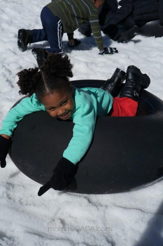 Girl relaxing on a snow tube, Big Bear, CA