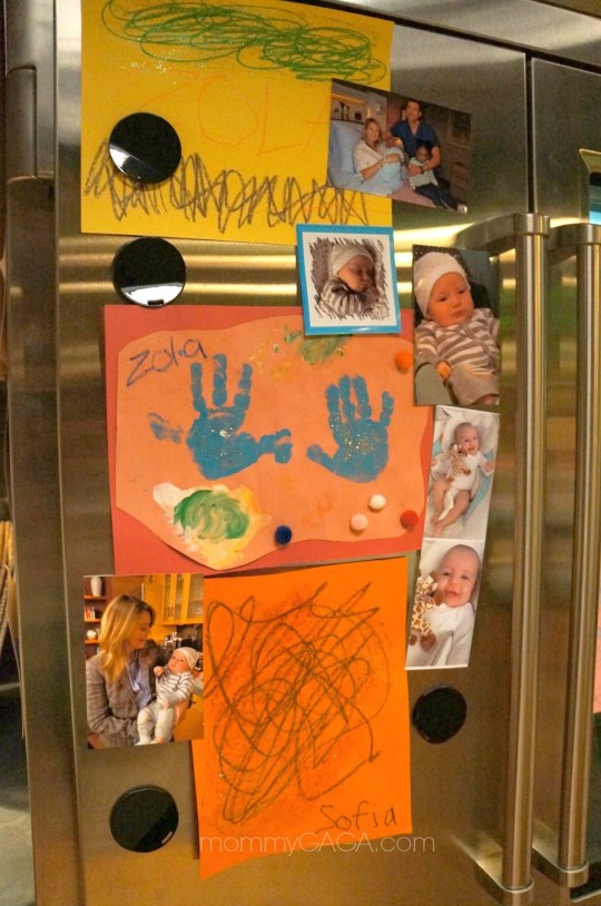 Grey's Anantomy set, baby pictures and drawings on the refrigerator