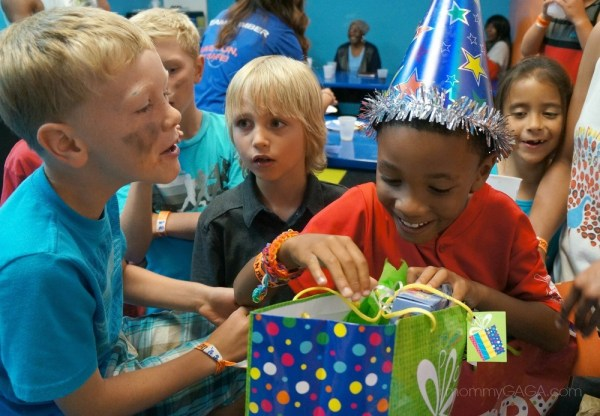 boy opening birthday gifts presents