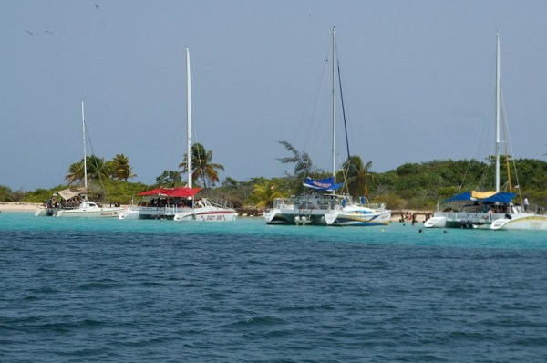 Catamaran Boats float on turquoise waters on Icacos Island, Puerto Rico