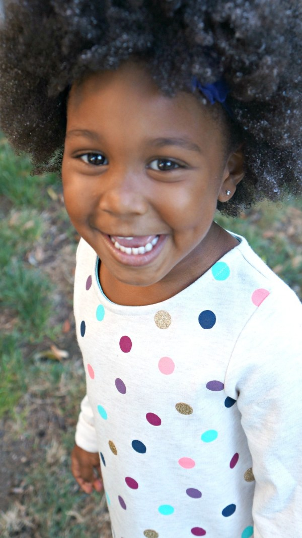 Happy little African American mixed girl smiling