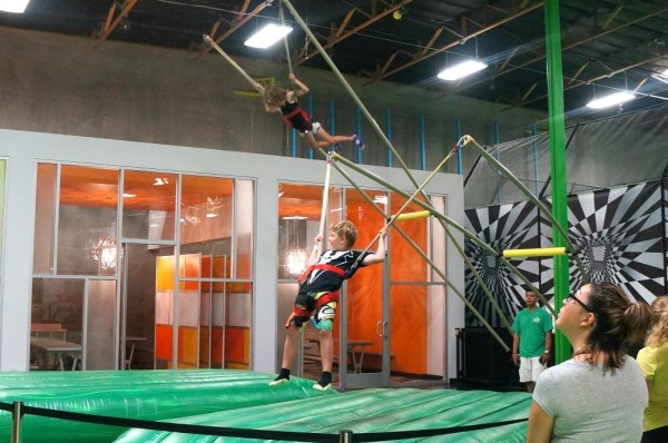 Kids on the floor bungee jumping at Jump Around Now