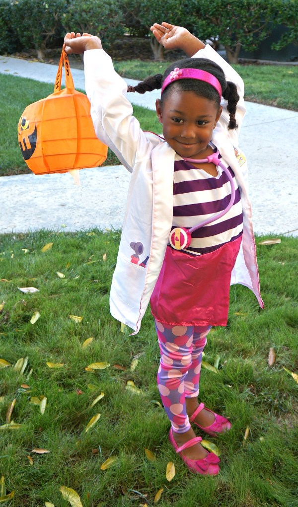Girl Trick or Treating in Doc McStuffins Halloween costume