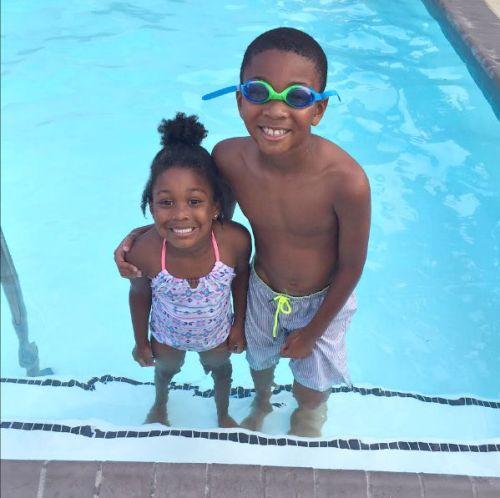 Beautiful brown mixed kids love swimming