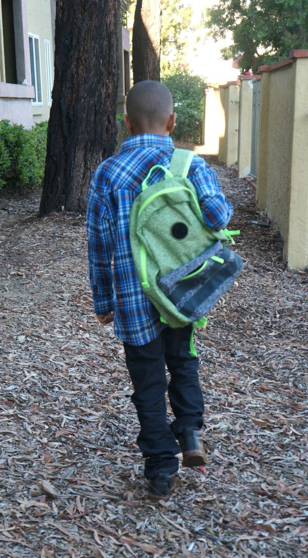 Kid walking back to school in Levi's Kids Denim