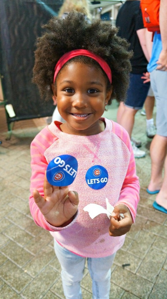 Girl collecting Cubs Stickers at Wrigley Field