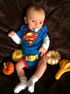 last year peanut was superman we got his costume from swapcom there arent many choices but i am all for usedhand me down baby attire if you can find