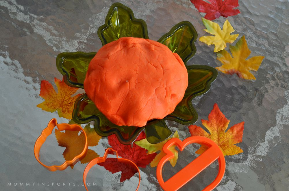 Pumpkin Playdough and fall leaves are the perfect after school activity!
