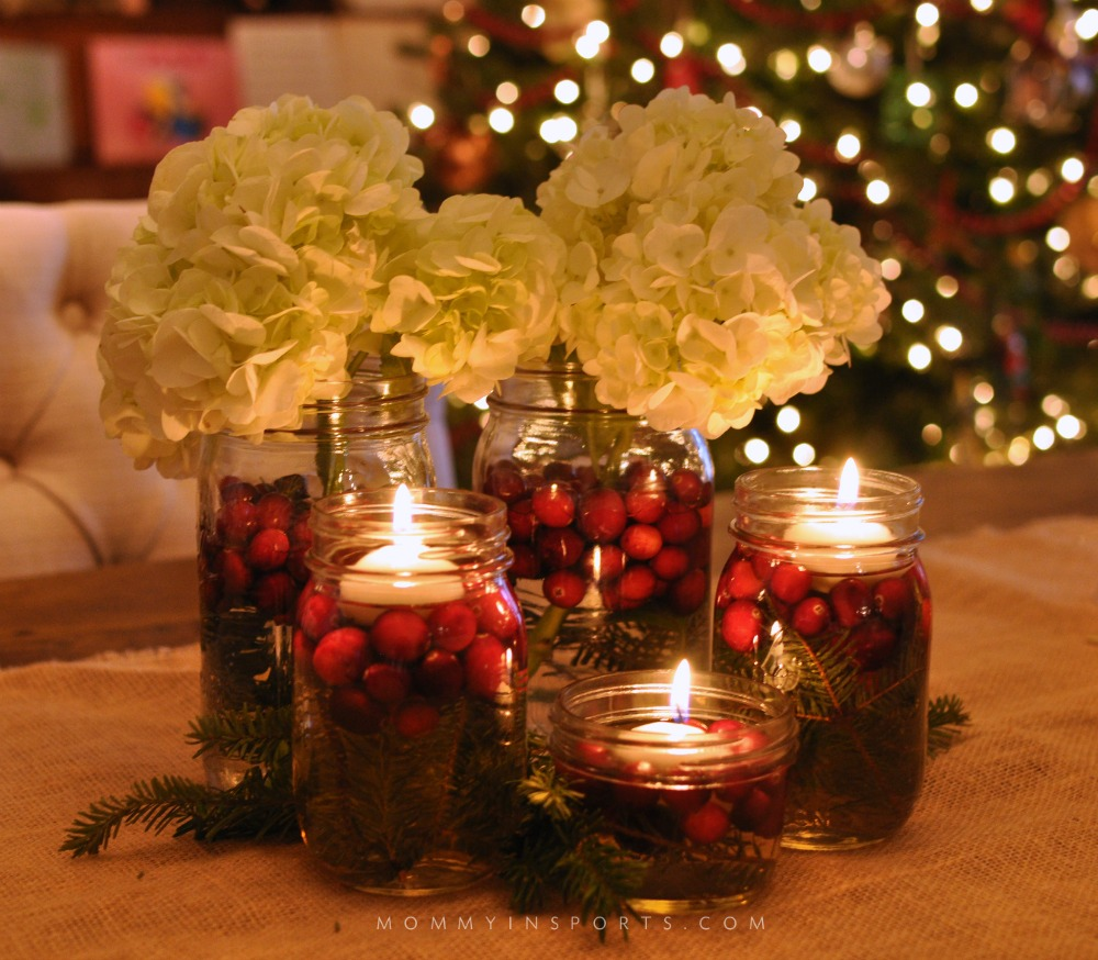Mason Jars are perfect to use for a holiday centerpiece! Fill them with flowers, cranberries, evergreen clippings, or even pine cones for a beautiful DIY holiday centerpiece!