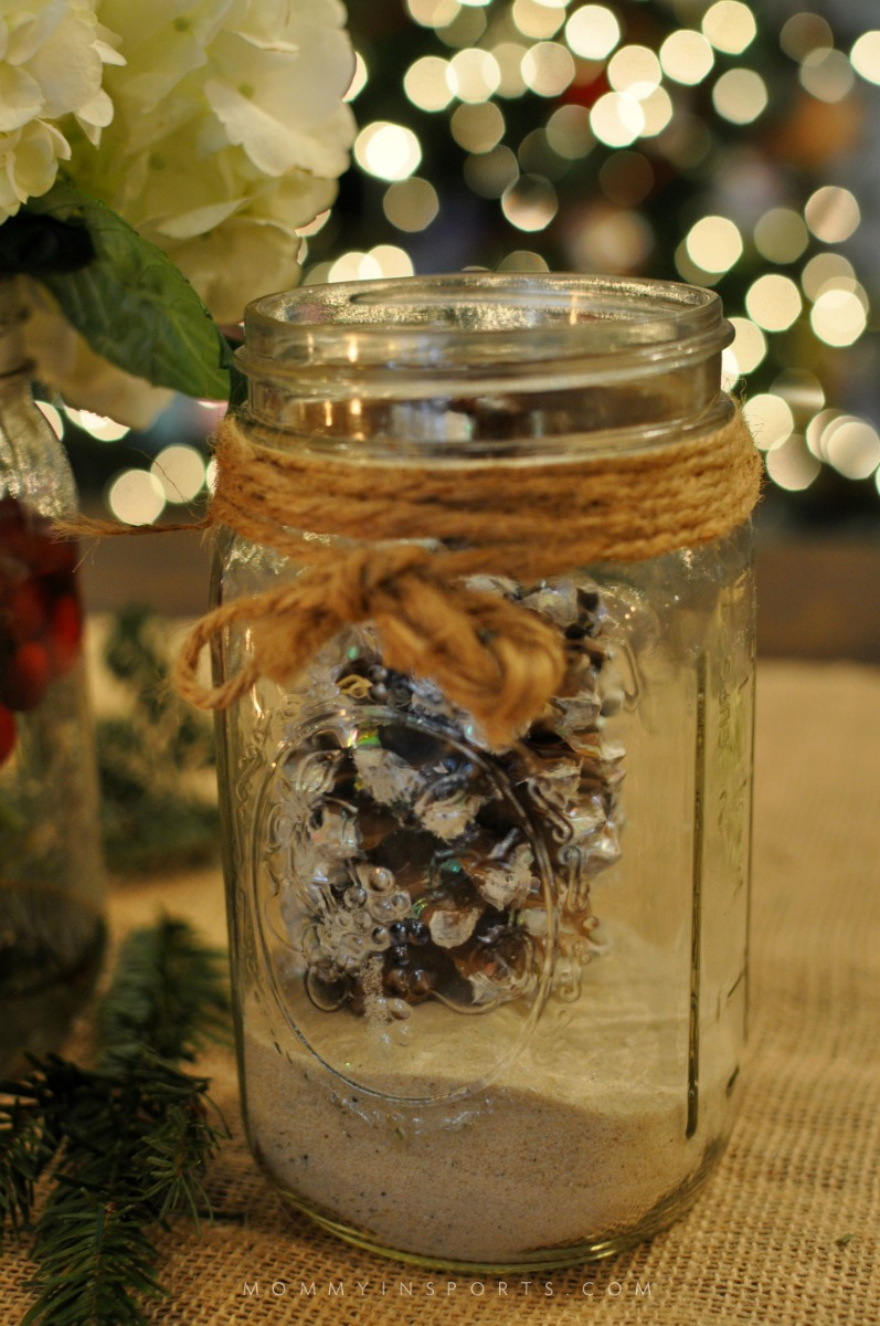 Mason Jars are perfect to use for a holiday centerpiece! Fill them with flowers, cranberries, evergreen clippings, or even pine cones for a pretty DIy holiday centerpiece!