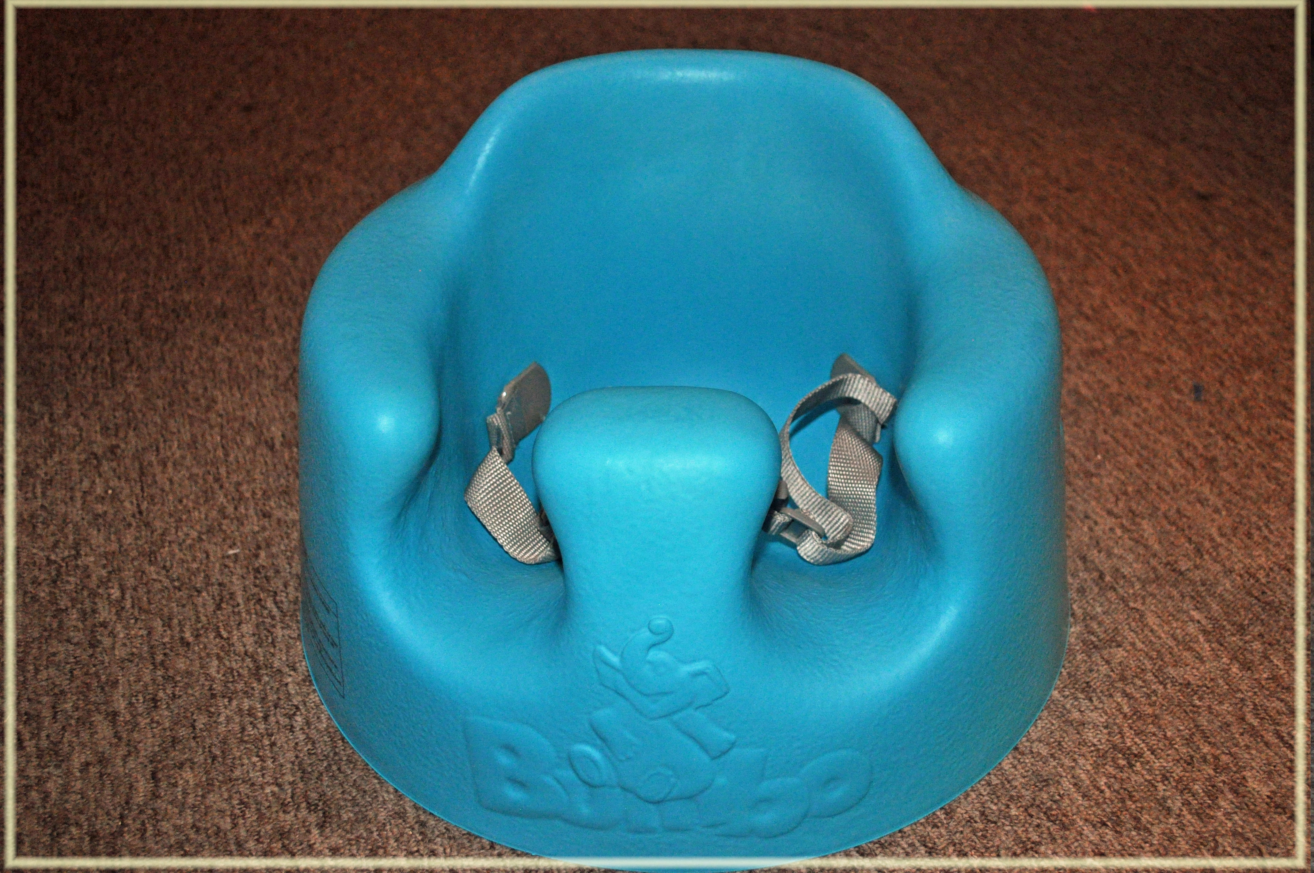 chair to help baby sit up black resin patio chairs must haves bumbo floor seat with play tray mommy