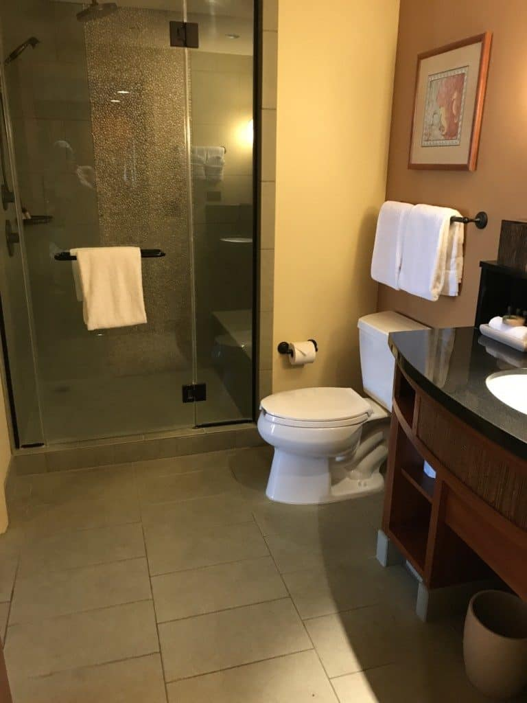 Separate shower area and sink in the Aulani suites