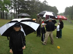 Waiting out some torrential rain, golf rules