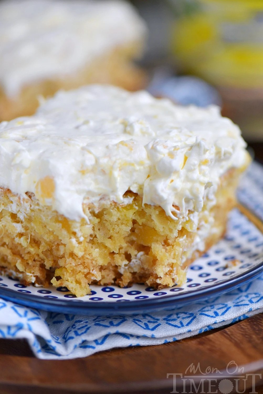 This Practically Perfect Pineapple Cake is loaded with pineapple flavor! Made without butter or oil, it's incredibly moist and topped with a delicious pineapple fluff frosting! // Mom On Timeout
