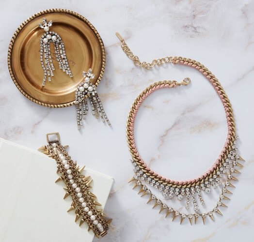 Photo of OUTFIT MAKERS $99 ($247 value) including earrings, necklace, and bracelet on a white marble background with a partial view of a white box.