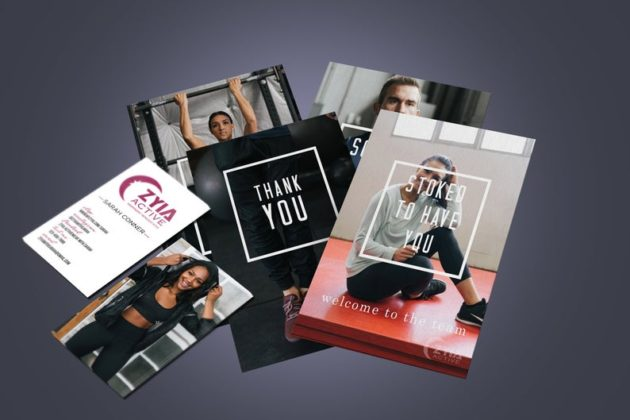 """Photo of various Zyia Active branded business cards and postcards depicting women and men wearing the clothing with words that say """"Thank you"""" and """"Stoked to have you""""."""