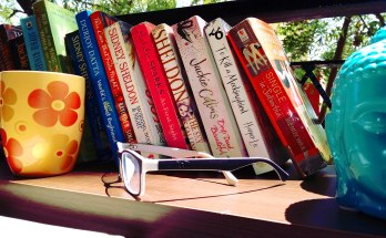 cup, specs, books