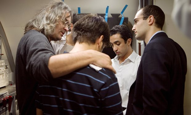 Paul Greengrass ( left) and Khalid Abdalla (right) on set of the film United 93. Photograph: Moviestore Collection/Rex
