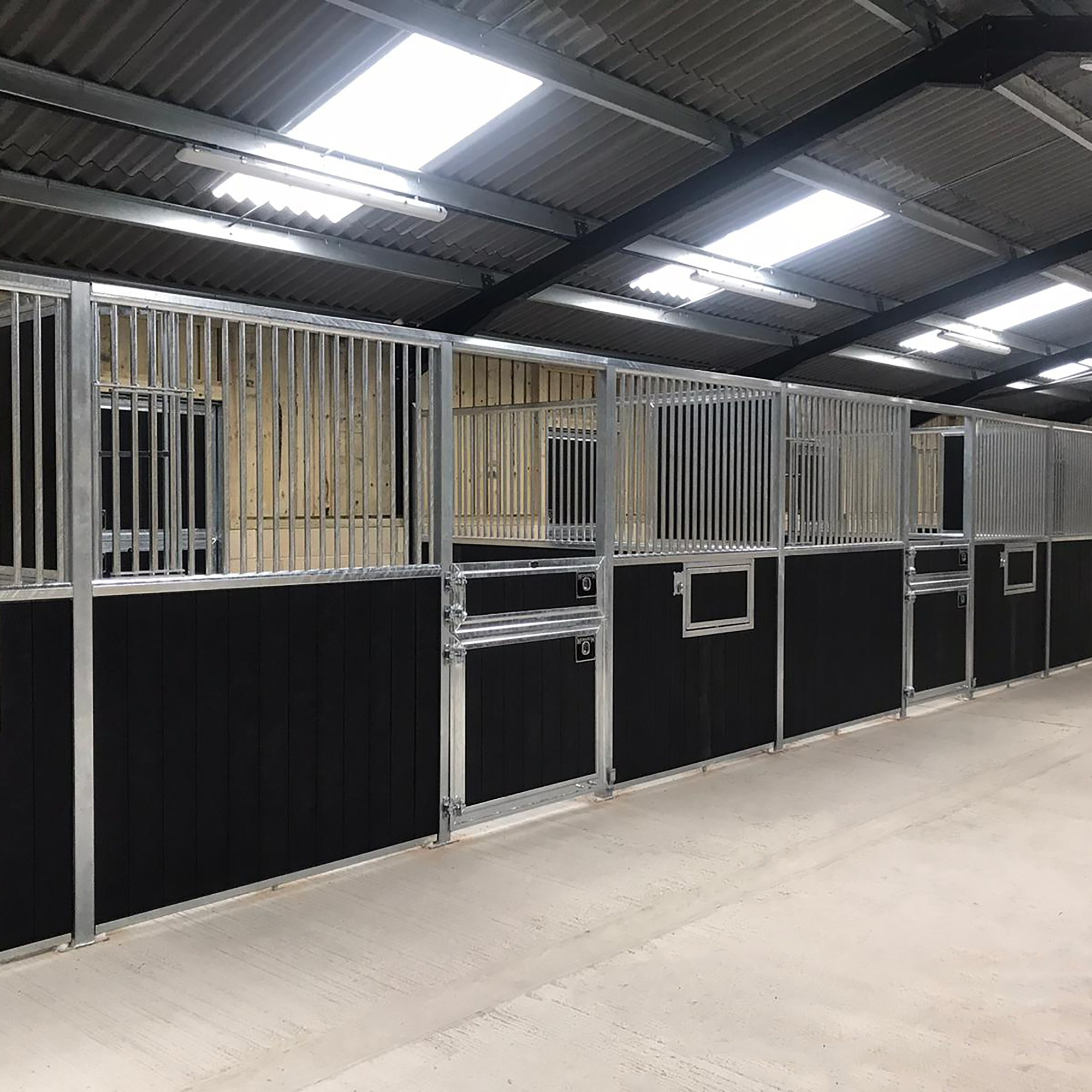 standard internal stables in black plastic by monarch equestrian