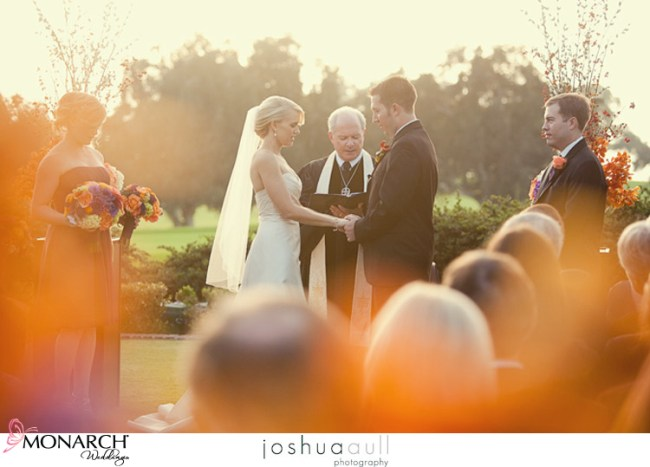 Lodge-at-torrey-pines-ceremony-on-lawn-orange-and-purple-wedding