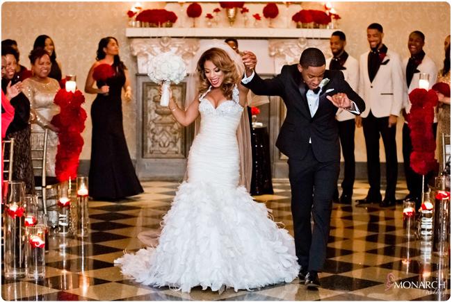 Us-Grant-Crystal-Ballroom-Bride-and-Groom-Celebrating-Red-Roses