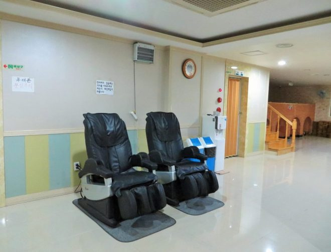 Massage chair on the common area of a jjimjilbang in South Korea a place to sleep and save money