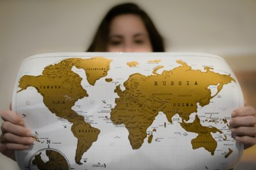 hold a map to show how to send money abroad with transferwise