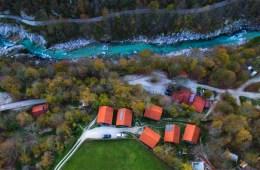 Aerial shot of Kamp Koren accomodation next to Soca River in the city of Kobarid, Slovenia