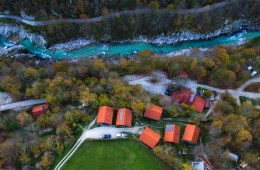 Aerial shot of Kamp Koren accomodation next to Soca River in the city of Kobarid, Slovenia