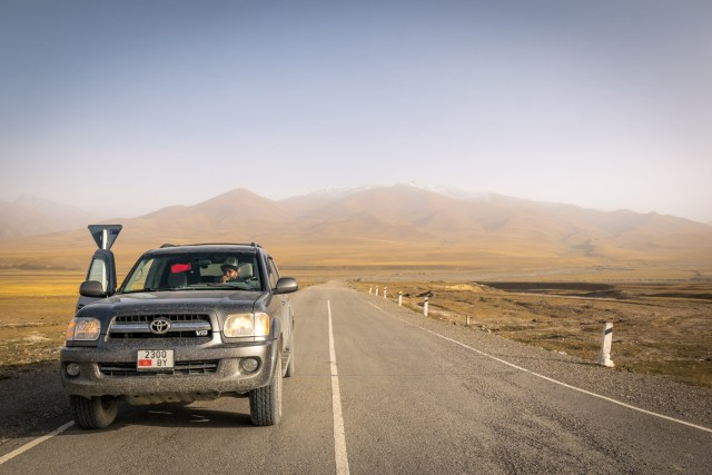 Monday Feelings resting by the road of Kyrgyzstan on an infinity motorway leading to a mountain