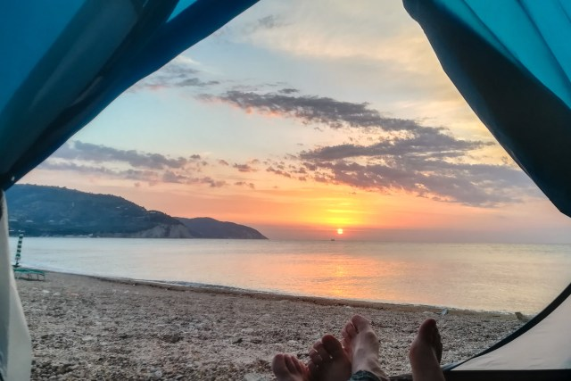 Sun rising in the sea horizon seen from our tent by the beach