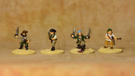 3 pirates armed with swords and another lighting a cannon (which is still to paint).