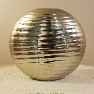 vaso rotondo in metallo lucudo